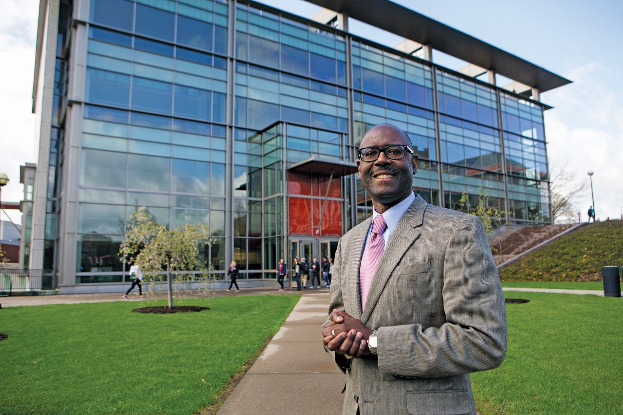 Terence Harrison stands in front of UC's University Pavilion.