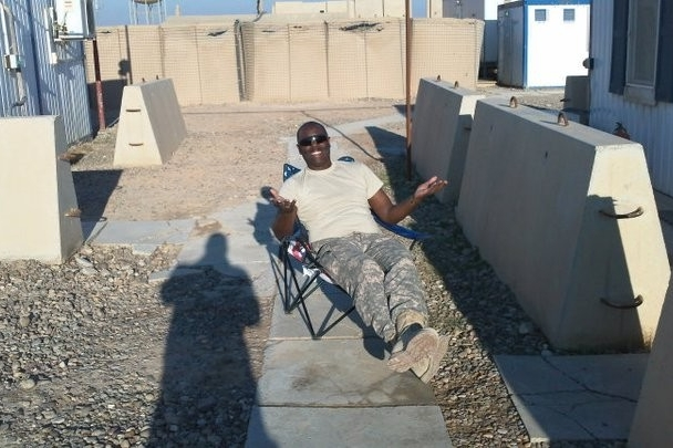 Terence Harrison relaxes in Iraq sitting in chair.