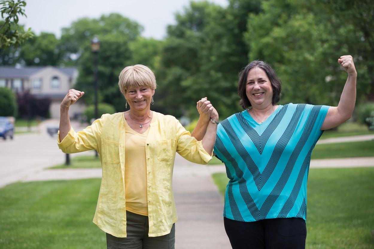 Beth Sininger Flege and Susan Kromer Hunt flex outside Flege's home