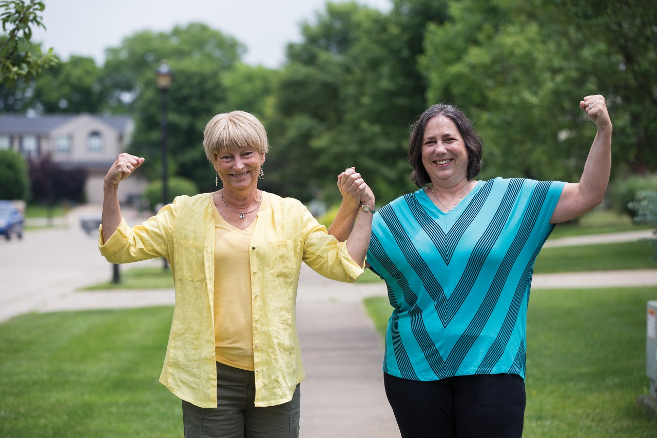 Beth Sininger Flege and Susan Kromer Hunt flex outside Flege's home