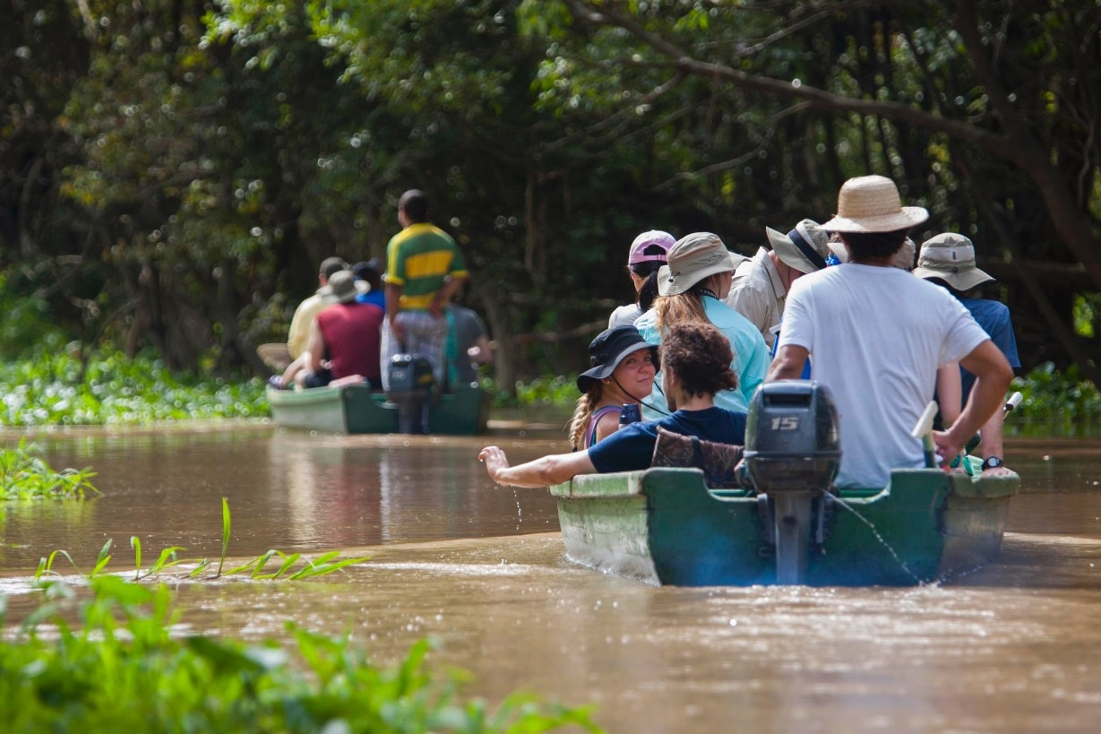 UC students float down the Amazon in a small boat