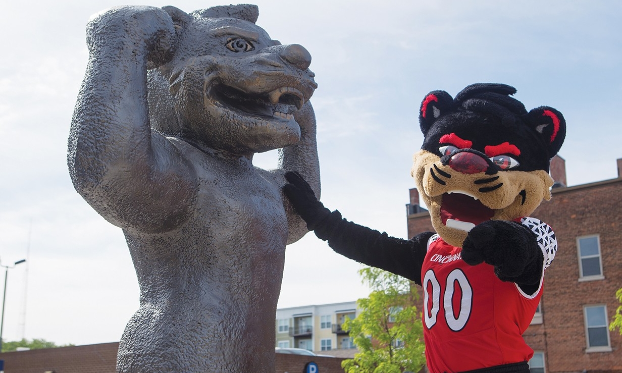 Bearcat mascot poses next to new Bearcat statue