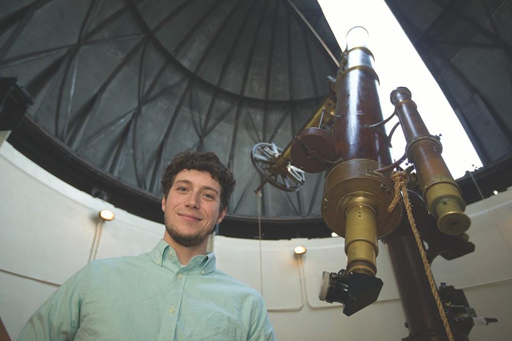 UC alumnus Kevin Wagner stands inside the Cincinnati Observatory