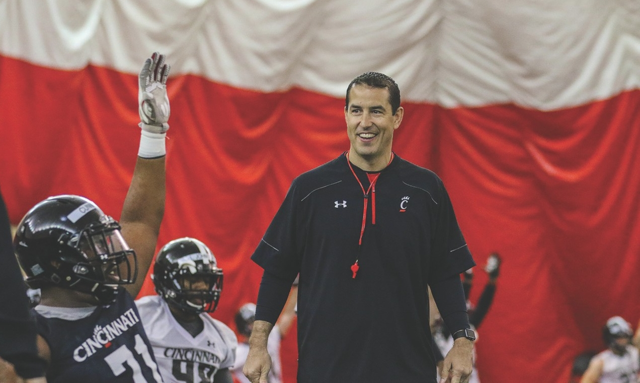 UC football coach Luke Fickell stands inside the team's indoor practice facility