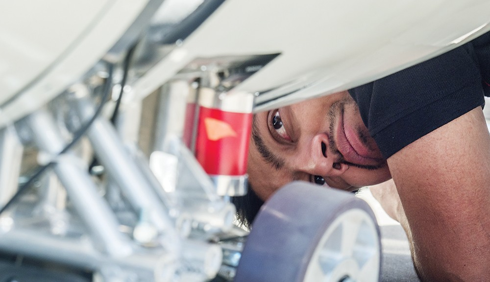 A member of the team that created a prototype pod for high-speed travel peers underneath the machinery.
