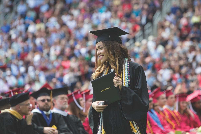 New graduate Codee Boyce holding diploma