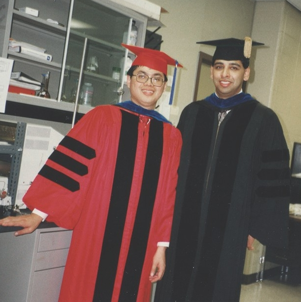 Neville Pinto and David Jen, both in commencement regalia