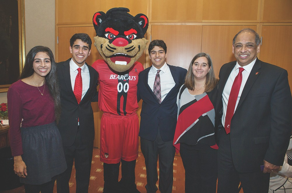 UC President Neville Pinto with his wife, three kids and the Bearcat mascot
