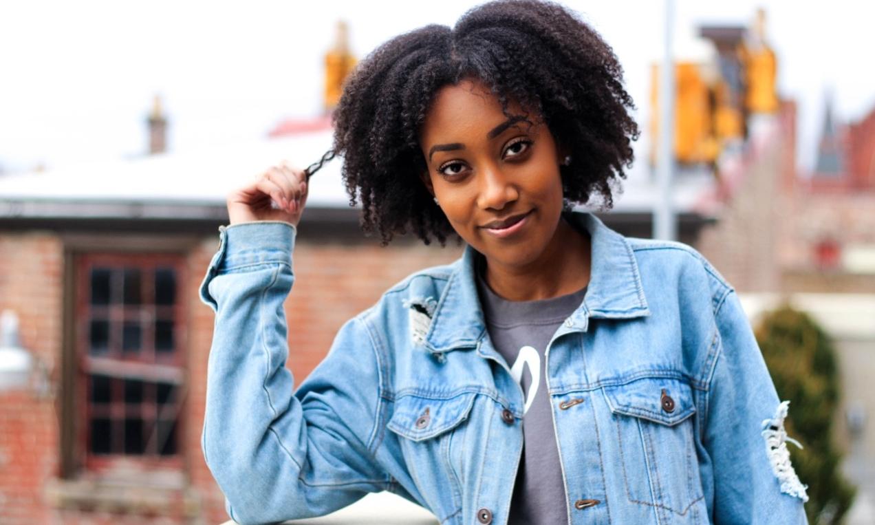 Sinna Habteselassie stands on a rooftop in Cincinnati