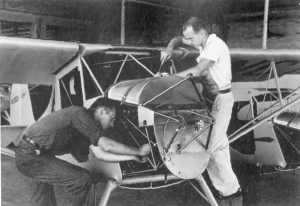 Ray Bisplinghoff and A.C. Ballauer work on an airplane.
