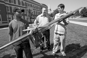 Rob Charvet, Cody Lafountain and Matt Finke hold a model airplane at UC.