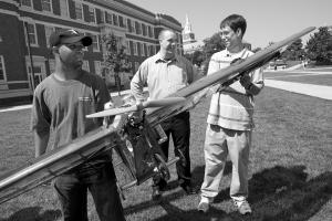 Rob Charvet, Cody Lafountain and Matt Finke hold a model airplane at UC.