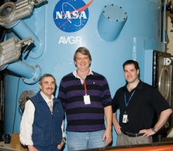 David Landis standing with LCROSS science team member Pete Schultz and NASA's Anthony Colaprete.