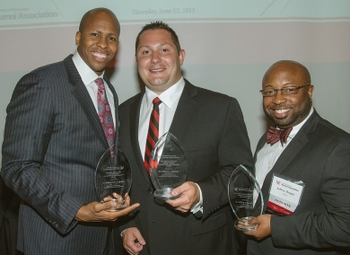 Three alumni honorees, Rob Richardson Jr., Bob Coppola and Jeffery Burgin, display their awards.