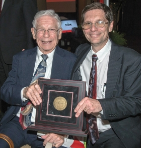 Dr. Joseph Broderick, who received the William Howard Taft Medal for Notable Achievement, sits with his father, Dr. Joseph Broderick.