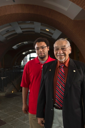 Clark Beck and his grandson Emory stand inside the Engineering Research Center at UC. Beck was one of two African-Americans who helped break the color barrier in engineering. With him is his grandson, Emory, one of hundreds of minority students he has mentored.