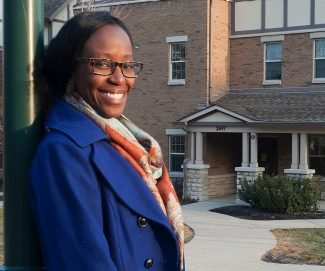 UC student N'deye Ba poses in front of the special first-generation housing.