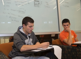 Two UC students work together in the Engineering Learning Center.