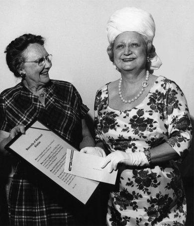 A vintage photograph from 1965 of UC benefactor Dolly Cohen presenting an award to UC teacher Jean Winston.
