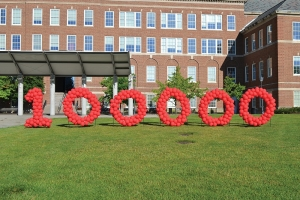 UC marked the reaching of 100,000 donors by spelling the milestone out with red balloons on McMicken Commons.