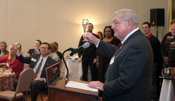 "The Foundation's interim president at the end of the campaign, Steve Wilson, A&S '66, MBA '68, HonDoc '06, raises his glass to offer a toast to launch the campaign's final leg, ""A Billion and Beyond."""