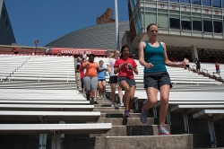 UC students and staff runs the steps of Nippert Stadium as part of the Stadium Steps Challenge.