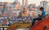 Boy on a piece of construction equipment in the midst of the protest in Turkey
