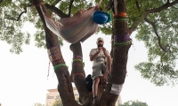 Turkish protestors build a hammock among the trees to sleep.