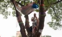 Turkish protestors build a hammock among the trees to sleep.