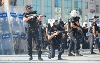 Police fire tear gas canisters at a group of protesters near Taksim Square on June 11