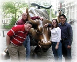 Breaking from their student business competition in New York last year, recent UC grads and iSE-Tek founders (clockwise from left) Mike Ross, Bill Kinnaird and Paolo Dominguez, with his spouse, Traci, paused next to Wall Street's massive bronze bull, much-rubbed by passers-by seeking to earn their fortune