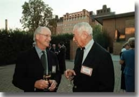 When world-renowned architect Michael Graves (left) visited his alma mater in 1999, he had time to reminisce with his first co-op employer, Carl Strauss, in front of the Engineering Research Center, which Graves designed for UC.