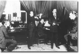 Brothers Albino and Romeo Gorno, professors at CCM's predecessor, the Cincinnati College of Music, performed with symphony violinist William Knox on WLW radio's first broadcast (station owner Powel Crosley Jr. at right). photo/courtesy of UC Department of Archives and Rare Books.