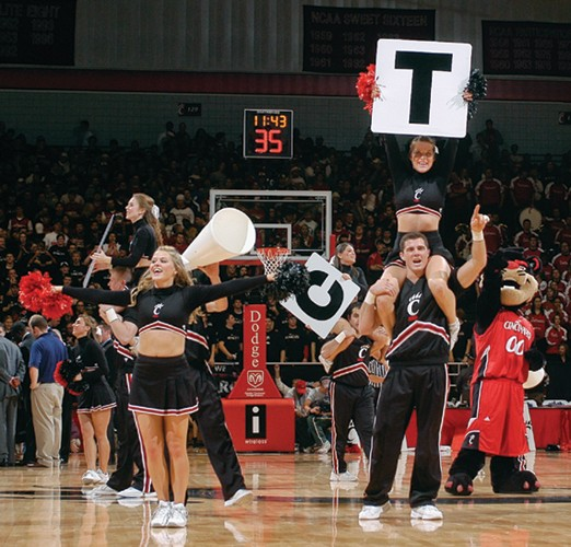 Short skirts aren't the only things that bare cheerleaders' skin these days. Here, the squad cheers UC to beat Xavier, 67-57, in the December '06 Crosstown Shootout.