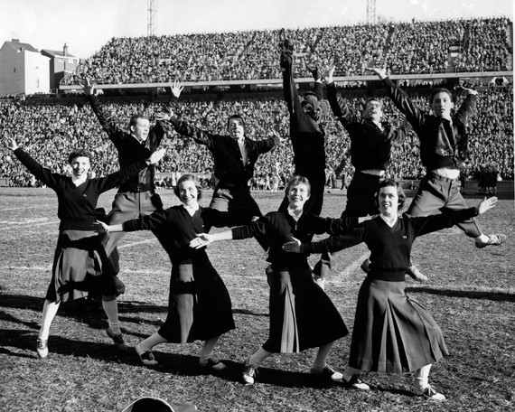 Basketball players' shorts may have been quite short 40-50 years ago, but cheerleaders' uniforms were ample, as exhibited by the 1956-57 squad. photo/Courtesy of Archives and Rare Books