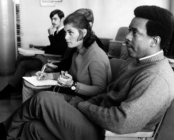 """In October 1968, this student is using an early """"communicator"""" in Dorelle Heisel's psychology and art class. The first of many electronic 'responders,' the device allowed a professor to measure how well students understood the lecture material. photo/courtesy of Archives and Rare Books"""