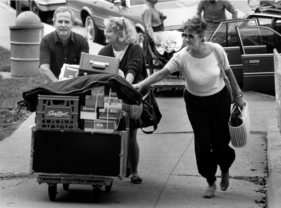 Moving into a dorm is as much work as ever.  Parents move in a daughter for the 1985 fall term. photo/courtesy of Archives and Rare Books