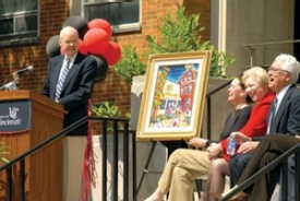 James Winkle makes a few light-hearted comments in June while saying thanks for the painting he was given in honor of his $10 million gift to the College of Pharmacy. Sitting, from left to right, are health-affairs provost Jane Henney, President Nancy Zimpher and pharmacy Dean Daniel Acosta.