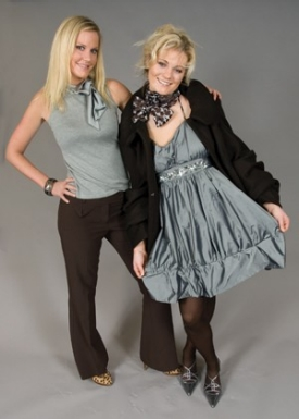 When 10 fashion design juniors were asked to design and exhibit fashions for the French-American Chamber of Commerce's gala dinner, they were impressed at the invitation and anxious to impress the group that represents hundreds of French companies with a local presence. Amy Goetz (left) designed this wool-cashmere coat and dress, modeled by Althea Harper.