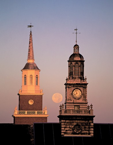 An October moon descends between the Tangeman clock tower and the McMicken cupola.