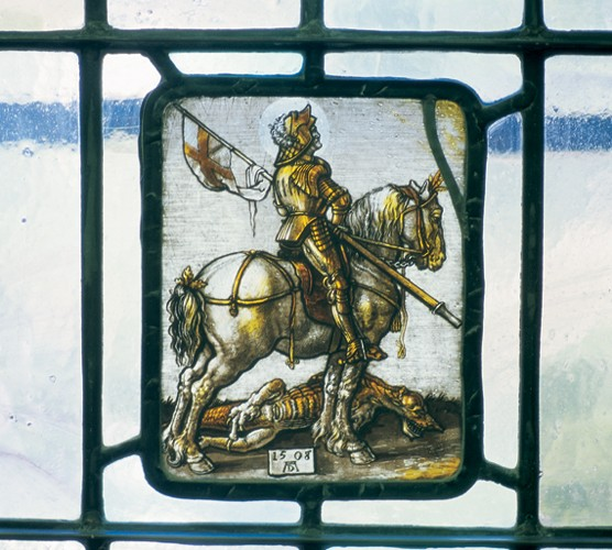 This preserved art glass panel of the dragon-slaying St. George was salvaged from UC's original medical lecture halls and is on display in UC's Center for the History of the Health Professions.