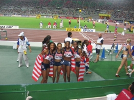Former Bearcat sprinter Mary Wineberg (third from left) helped the American 400 relay team win gold at worlds in 2007 in Osaka, Japan.
