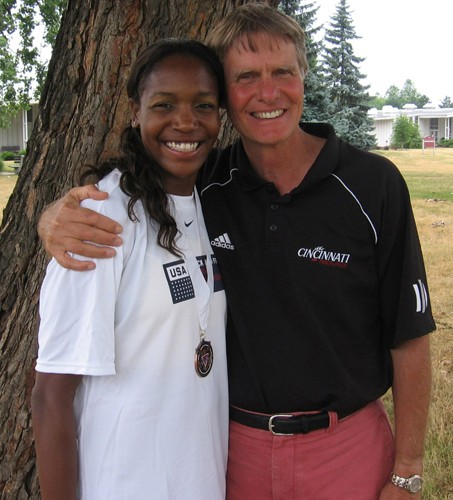 Former UC sprinter Mary Wineberg with Jim Schnur, UC's longtime women's track coach. Schnur continues to coach Wineberg, now a world-class 400-meter runner.