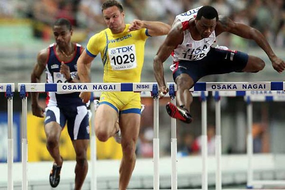 David Payne competes in the 110 hurdles at world competition in Japan in 2007. He won the bronze medal.