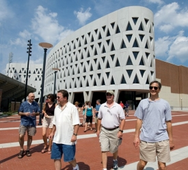 Lots of wow's echoed across UC's main campus in the summer of 2007 when 14 alumni from the '70s came by. Bernie Joyce, A&S '77 MBA '83, had requested the tour for a group of friends coming to an informal reunion. ''It wouldn't have been the same celebration without the tour; it was fantastic,'' he says. ''It gave us an opportunity to remember things we hadn't thought about in 30 years.'' Leaving the Richard Lindner Center (from left) are Bill Pickens, A&S '77; Nancy Coyne, wife of Joe Coyne, A&S '77, MA (A&S) '79 (not pictured); Bernie Joyce, father of Megan Joyce, A&S '06 (not pictured); Joel Palin, A&S '81; and Joe Haas, Bus '77.