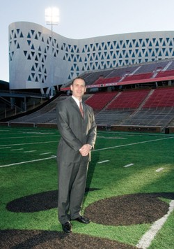 Mike Thomas, 45, has taken the reins as UC's athletic director. Behind Thomas is the Richard E. Lindner Center, which will house sports offices, practice gym, auditorium, ticket office and new faculty club.