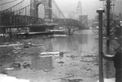 The Roebling Suspension Bridge -- the architect's prototype for New York's Brooklyn Bridge -- still stands above the Ohio River's 80-foot crest in January, 1937. Downtown Cincinnati can be seen in the distance.