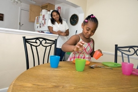 Serenity practices her chores at UC's Arlitt Child and Family Research and Education Center.