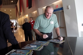 Former Bearcat Bob Wiesenhahn signs the Sports Illustrated cover