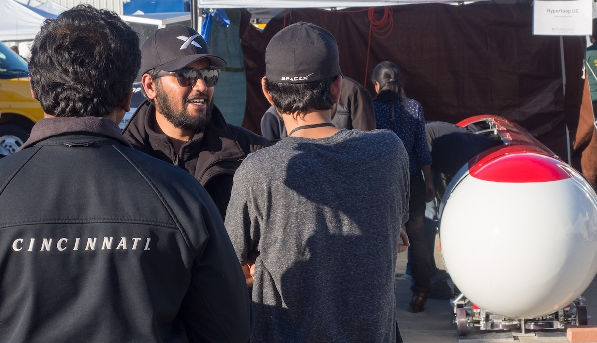 Dhaval Shiyani works with the Hyperloop UC engineering crew to troubleshoot their pod.